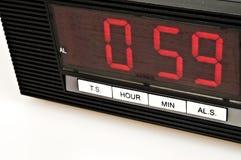 Clock. Showing 0:59 isolated on white background stock image
