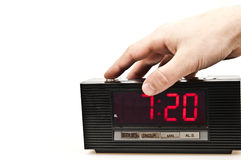 Clock. Male hand stopping alarm clock Stock Photography