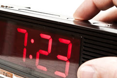 Clock. Male hand stopping alarm clock Stock Images