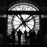 Clock. People in front of a big Clock royalty free stock photos