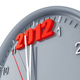 Clock with 2012. Round clock with arrows and red number 2012  in the top part Stock Photo