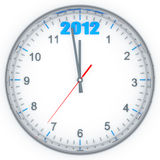 Clock with 2012. Round clock with arrows and blue number 2012  in the top part Stock Photo