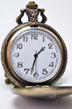 Clock. Wintage old metal pocket clock on white background Royalty Free Stock Images
