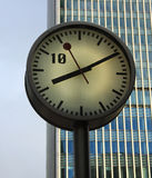 Clock. A clock with a skyscraper as background stock image