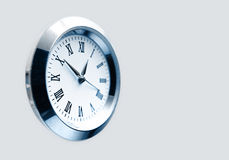 Clock. Isolated in silver show time Royalty Free Stock Photography