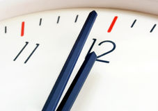 Clock. White clock shows twelve close-up Stock Photos