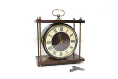 Clock. Antique clock isolated on a white background Royalty Free Stock Photo