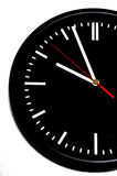 Clock. Black Wall clock isolated over a white background stock photography