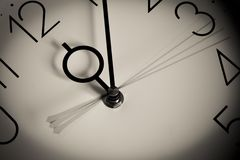 Clock. Multiply Hour hands on white clock Royalty Free Stock Images