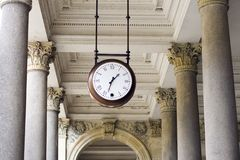 Clock. A clock hanging among pillars in the spa colonnade Stock Photos