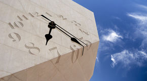 Clock. Surreal Salvador Dali Clock engraved on a modern building granite roof Royalty Free Stock Photos