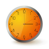 Clock. Wall clock with orange face and metal round