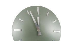 Clock (5 min to 12) over white Royalty Free Stock Images
