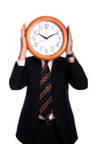 Clock. Businessman holding a clock isolated on white Royalty Free Stock Images
