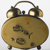Clock. Back of an old alarm clock Stock Photos