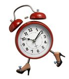 Clock. Close up of red closk with legs running on white background with clipping parh Royalty Free Stock Images