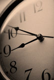 Clock. Hanging on a wall - sepia Royalty Free Stock Photo
