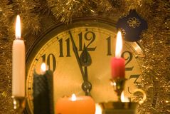 Clock. A clock with burning candle Stock Images