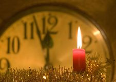 Clock. A clock with burning candle Stock Photography