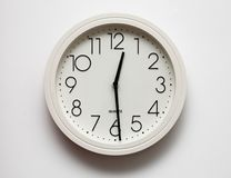 Clock. A white quartz clock with black numbers Stock Photography