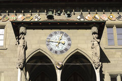 Clock above the porch of Town Hall in Bern Royalty Free Stock Images