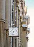 A clock in the administrative building of Irkutsk city. Stock Photo