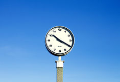 Clock against blue skies Royalty Free Stock Image