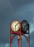 Clock against moody sky Stock Image