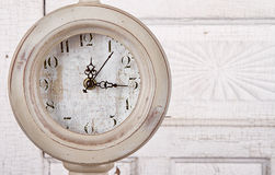 Clock on aged background Royalty Free Stock Photos