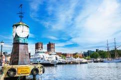 Clock on Aker Brygge dock, modern Oslo in Norway royalty free stock image