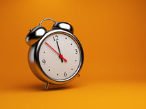 Clock alarm 3D. Time concept. On orange Stock Image