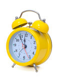Clock. Alarm clock, in a yellow box Stock Photos