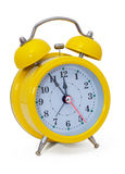 Clock. Alarm clock, in a yellow box. On a white background. Isolated Royalty Free Stock Photos