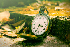 Clock on ancient brick,vintage color. Royalty Free Stock Image