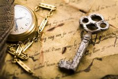 Clock & Ancient manuscript Royalty Free Stock Images