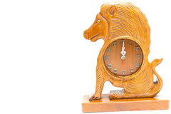 Clock antique wooden lion isolated over white Stock Image