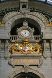 Clock In Antwerp, Belgium Train Station. Clock at front entrance of the Antwerp, Belgium train station royalty free stock photos
