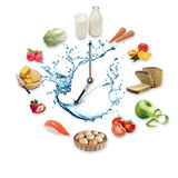 Clock arranged from healthy food products splash by water isolated on white background. Healthy food concept. Royalty Free Stock Images