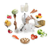 Clock arranged from healthy food products and young boy dressed Royalty Free Stock Images