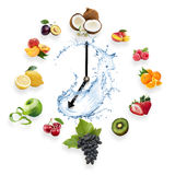 Clock arranged from healthy fruits splash by water isolated on w Royalty Free Stock Photography