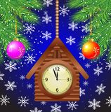 Clock as a house and green branches of christmas tree Stock Images