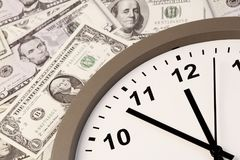 Time is money. Clock on assorted American banknotes. Time is money idea Royalty Free Stock Images