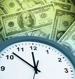 Time is money. Clock on assorted American banknotes. Time is money idea Royalty Free Stock Image