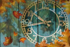 Clock and autumn leaves background - daylight saving time concept. Clock face and autumn leaves background - daylight saving time concept vector illustration