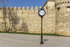 The clock on the background of the old fortress in Baku Royalty Free Stock Images