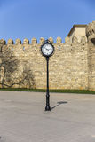 The clock on the background of the old fortress in Baku Stock Photos