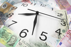 Clock and Bank Notes Stock Images