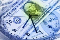 Clock and banknotes. Stock Photography