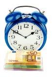 Clock and banknotes Stock Photos