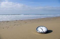 Clock on a beach Stock Photography